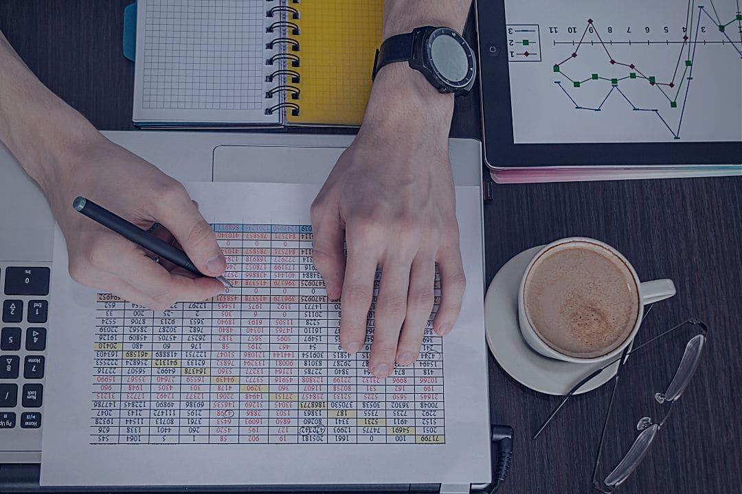 Man working on spreadsheet