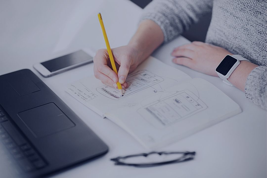 Man sketching app design