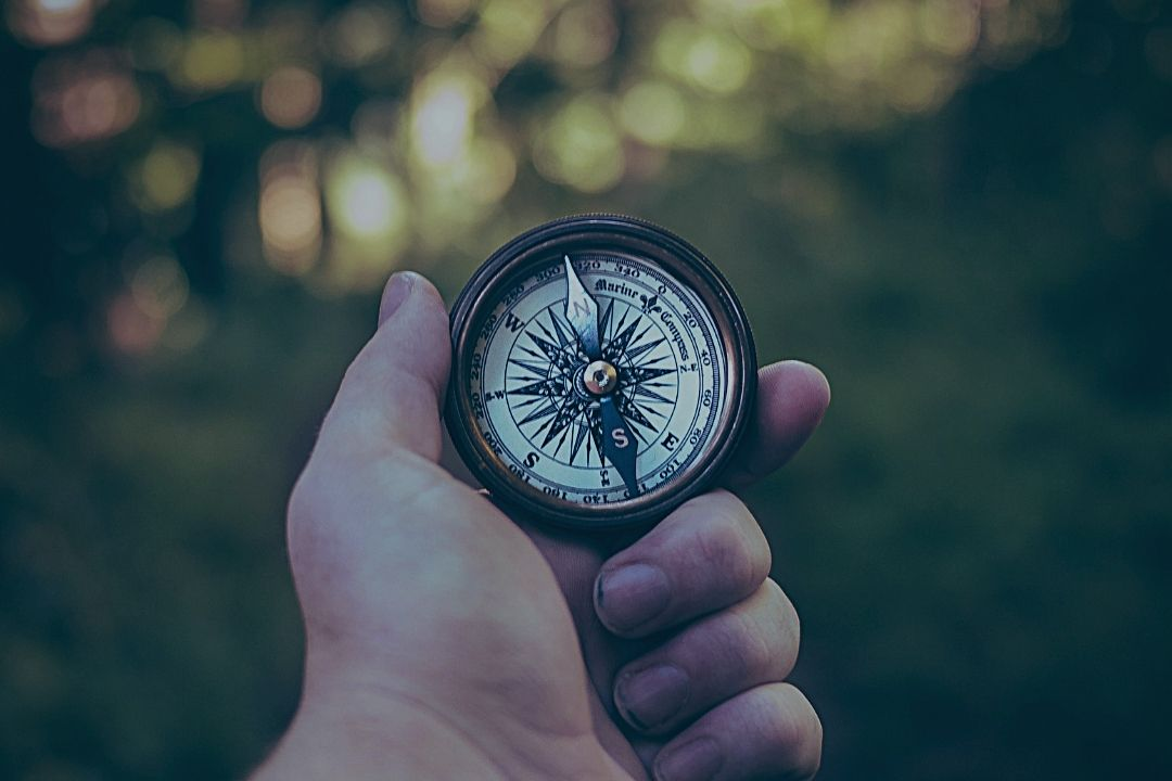 Compass in man's hand