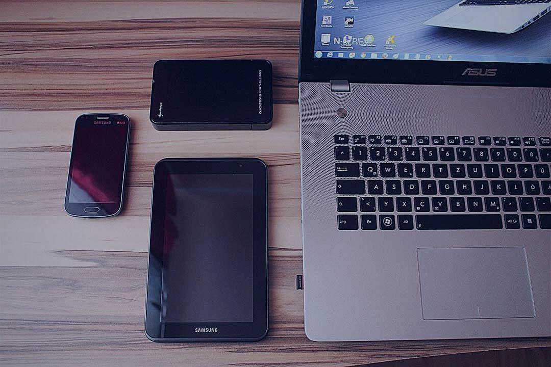 Tablet, smartphone and laptop on desk