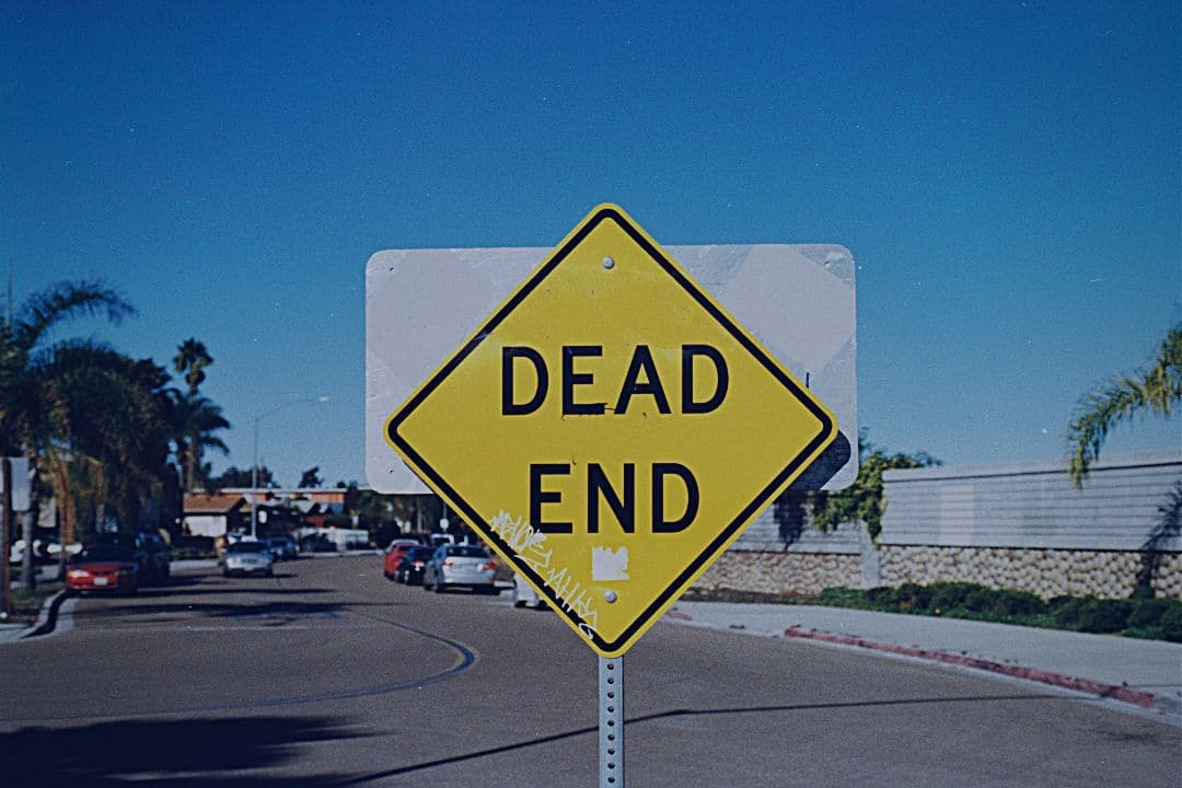 """Dead End"" sign on street"