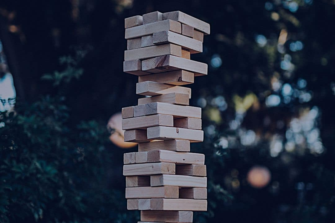 Wooden blocks balancing in a tall stack