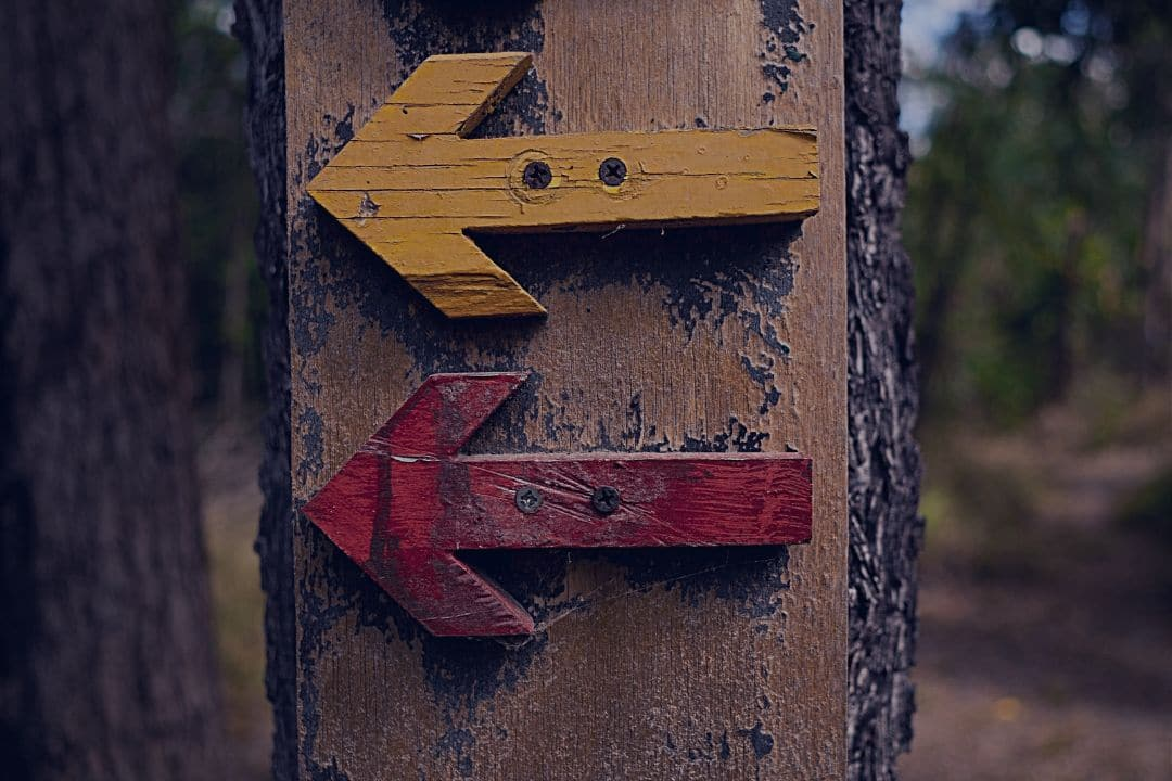 Wooden arrows on post